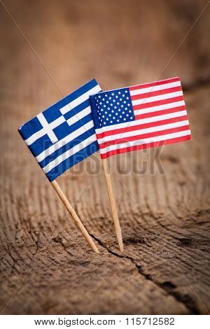 Flags of Greece and USA on wooden background