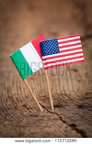 Flags of Italy and USA on wooden background