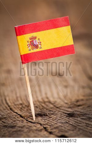 Stylized flag of Spain on wooden background