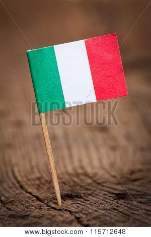 Stylized flag of Italy on wooden background