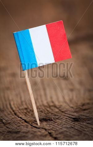 Stylized flag of France on wooden background