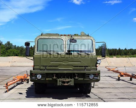 MOSCOW REGION  -   JUNE 13: Airfield wheeled drawing vehicle for towing aircraft and other aviation equipment  on June 13, 2015 in Moscow region