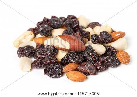 Dried fruits and nuts on a white background. Student meal.
