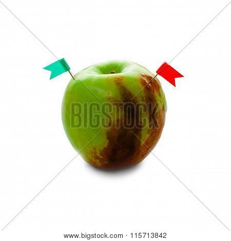 half-rotten green apple with two flags