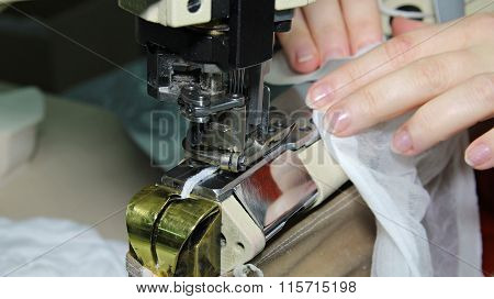 Woman Sewing On A Sewing Machine