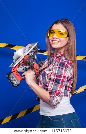 Plus-size Model On A Blue Background With The Construction Of The Protective Tape In Goggles Holding