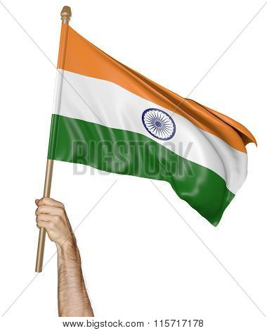 Hand proudly waving the national flag of India