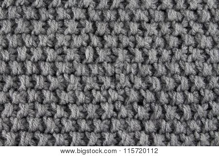 Grey knitted close up background