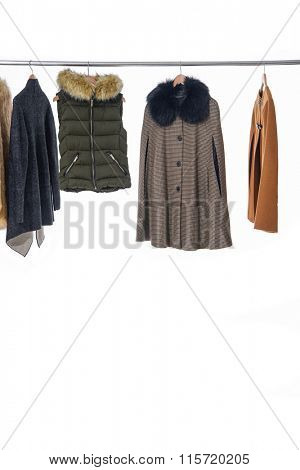 female clothes with coat on Hangers