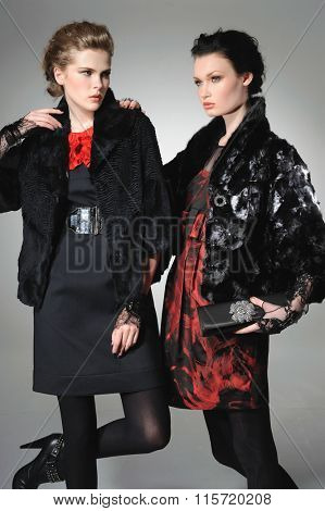 Young fashion two girl wearing black and red clothes posing