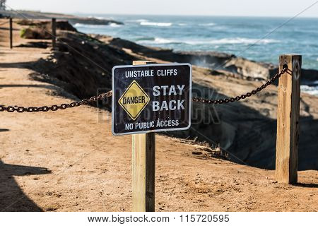 Danger Sign with Trail Background at Sunset Cliffs