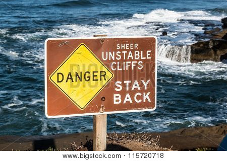 Danger Sign with Ocean Background at Sunset Cliffs