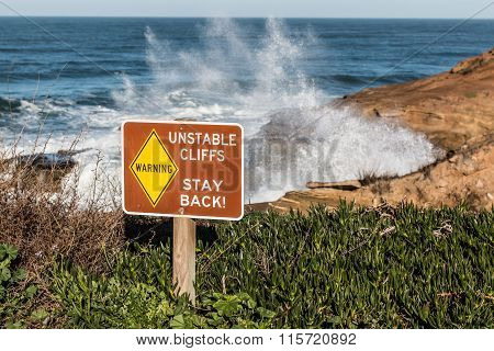 Danger Sign with Crashing Waves at Sunset Cliffs
