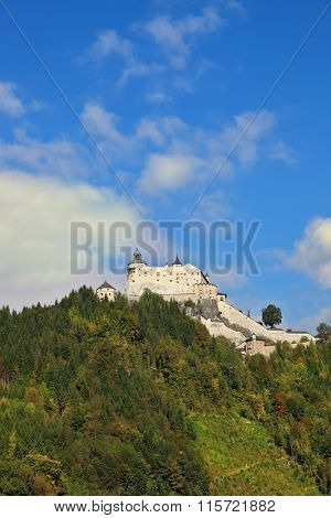 Fortress it is located at top of the mountain and it is surrounded with the dense wood.  Majestic medieval Burg Hohenwerfen