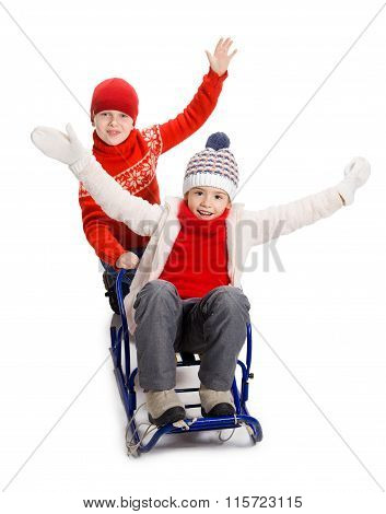 Two happy kids in winter clothes on sled