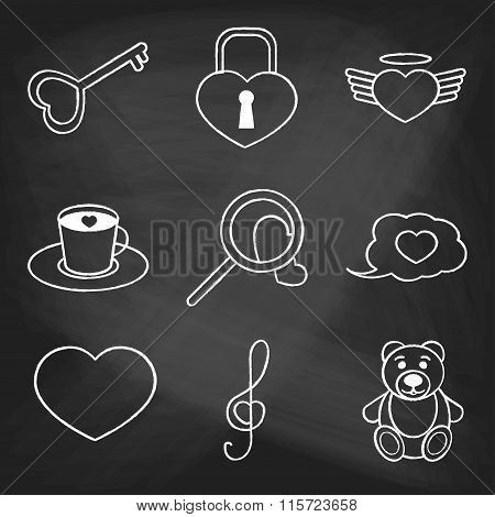 Set of love icons painted with white chalk on a blackboard. Decorative icons for Valentine's day. Ha