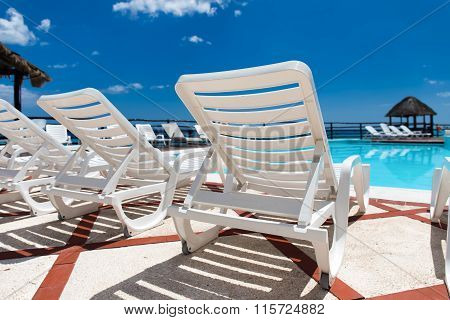 Lounge Sunbeds Near Swimming Pool