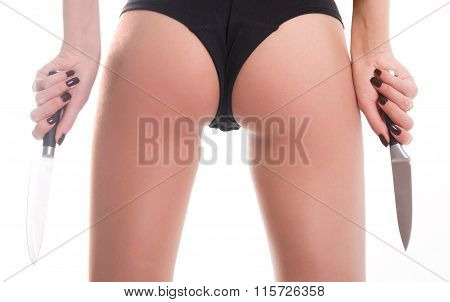 close-up ass slim girl in a bathing suit, a girl holding two knives. concept danger girl