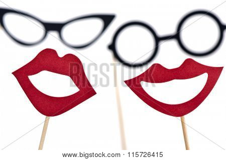 eyeglasses and mouths forming the faces of a man and a woman, on a white background