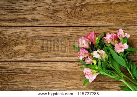 Bouquet Of Pink Alstroemeria On Wooden Plate