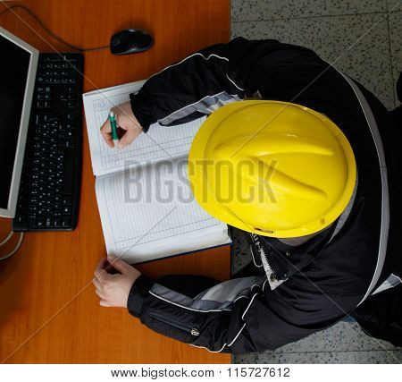 Technician Writing Data In The Power Plant Control Center