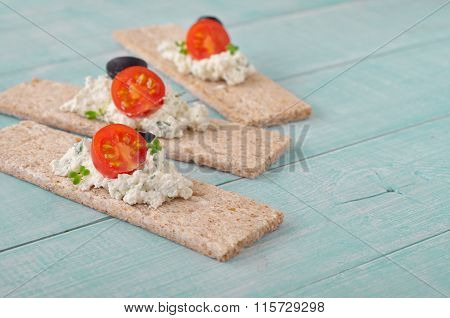 Dry Bread With Cottage Cheese, Cherry Tomatoes And Black Olives