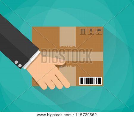 Hand carrying a cardboard box