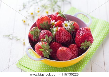 Fresh Organic Strawberry In Bowl On Towel On  White Painted Wooden Background.