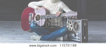 girl with guitar and tape