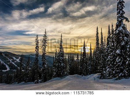Sunset over the ski hills at Sun Peaks village