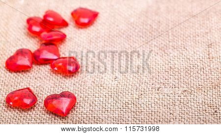 Red Glass Hearts Are Scattered On A Napkin From A Sacking