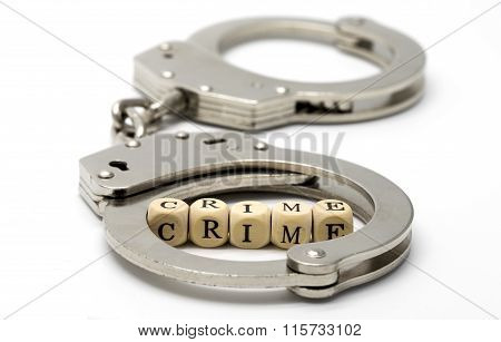 Handcuffs With Word Crime On Wooden Cubes