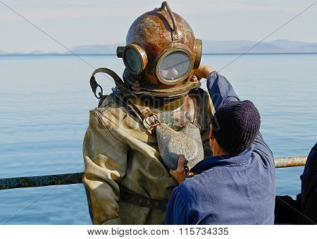 Diver In Heavy  diver suit.