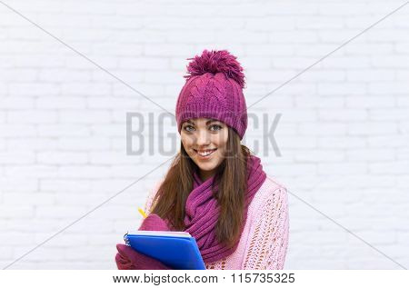 Attractive Student Smile Teenage Girl In Pink Hat Holding Folder Pencil