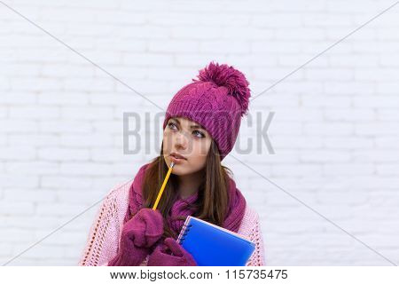Student Copy Space Pondering Attractive Girl In Pink Hat Holding Folder Pencil