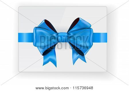 Bow Ribbon On Gift Box. Top View. Blue Bow.