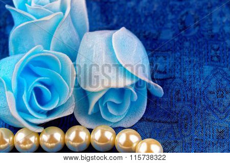 Pearl necklace with blue satin background