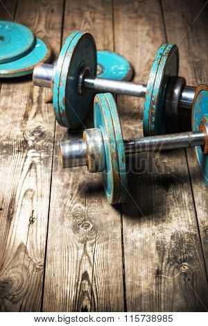 The Old Dumbbell On The Wooden Floor