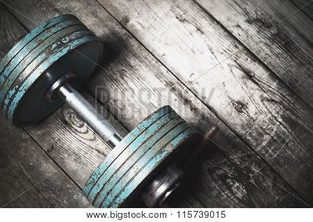 The Old Dumbbell On The Wooden Floor.