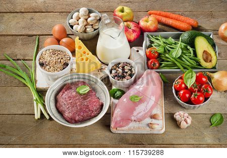 Assortment Of Fresh Vegetables And Meats For Healthy Diet On  Wooden Background.