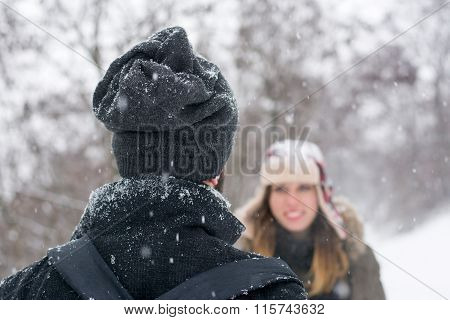 Boy And Girl Looking At Each Other In The Snow