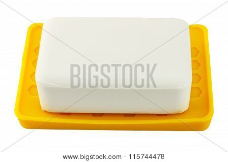 White Soap On Yellow Holder Isolated On White Background