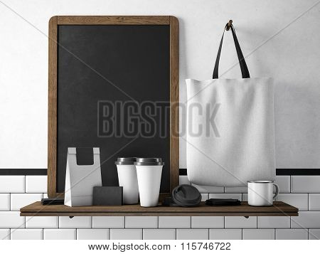 Black chalkboard on bookshelf with set of blank elements. 3d rendering