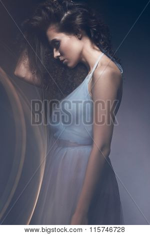 Beautiful girl in light blue dress and long hair, fashionable image. Beauty fashion style.