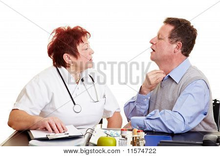 Man With Sore Throat Seeing Doctor