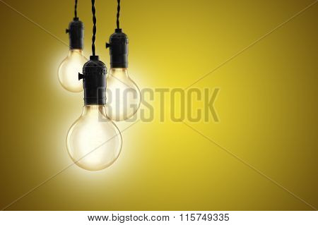 Idea Concept - Vintage Incandescent Bulbs On Yellow Background