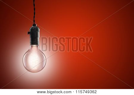 Idea Concept - Vintage Incandescent Bulb On Red Background