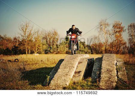 Enduro Racer Sitting On His Motorcycle