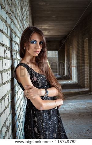 Beautiful, innocent, young, attractive, lonely, upset girl, woman, teenager dirty, interior, grunge, wall, background, ruin, desolate, destruction, urban, hall, nobody, rusty, manufacturing, abandoned, no freedom, exist.