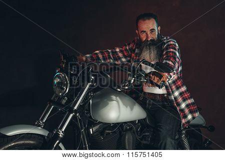 Casual Cool Long Beard Man On Motorcycle.